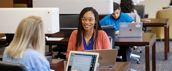 Students studying in the Law Commons reading room.